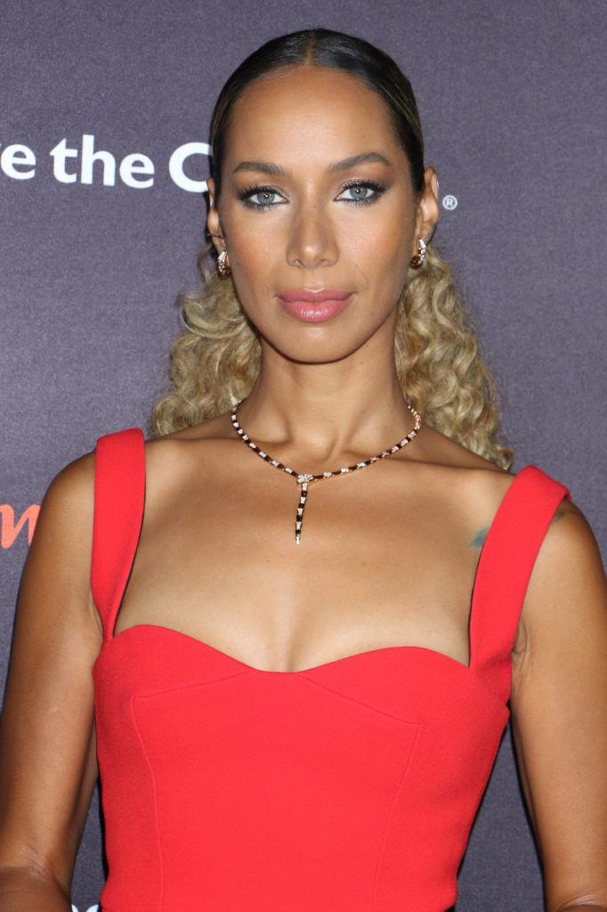 leona lewis smooth back low ponytail with curly blonde hair