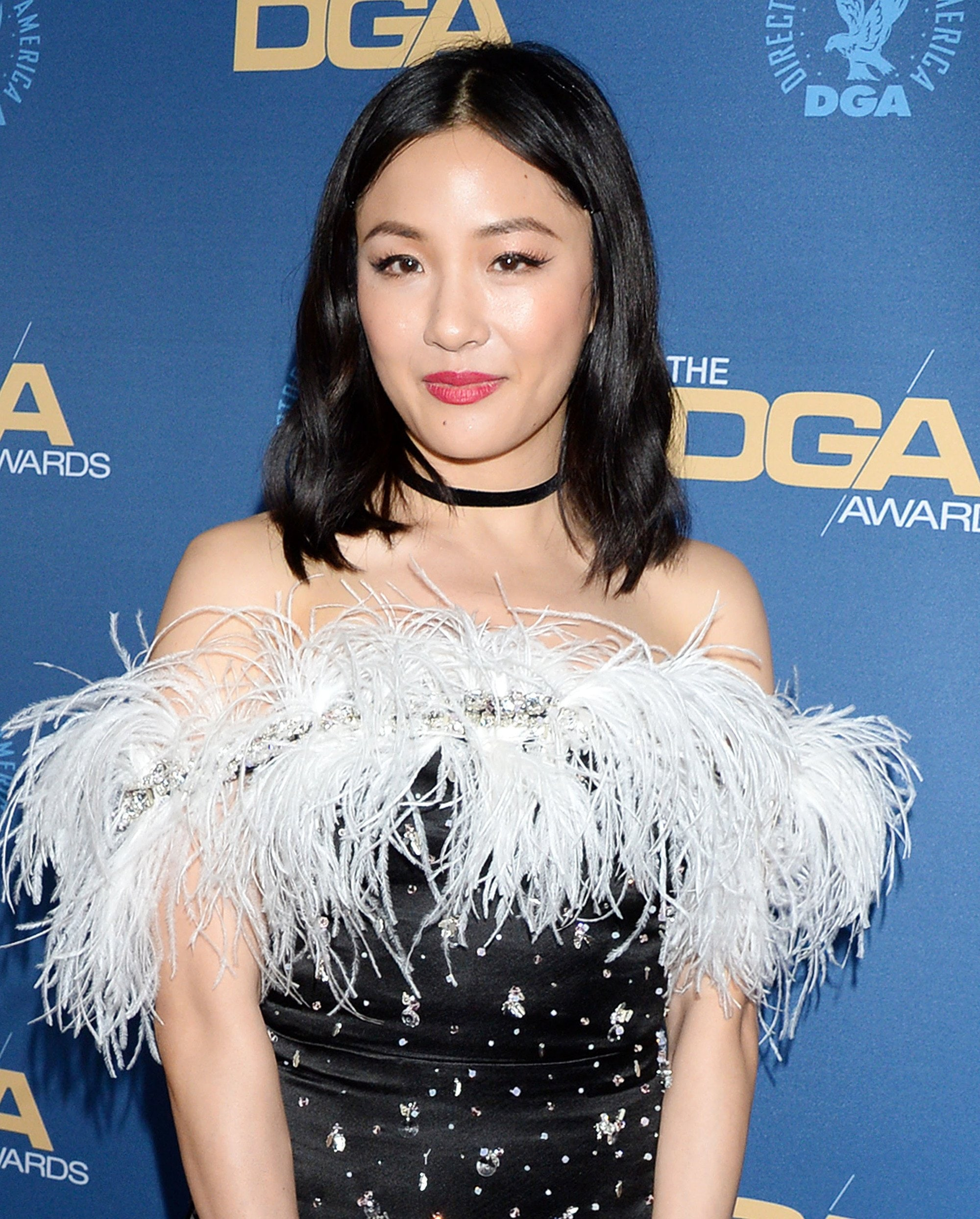 Celebrity Valentine's Day Hair: Constance Wu on the red carpet shoulder-length loose waves, wearing a fluffy black dress on the red carpet