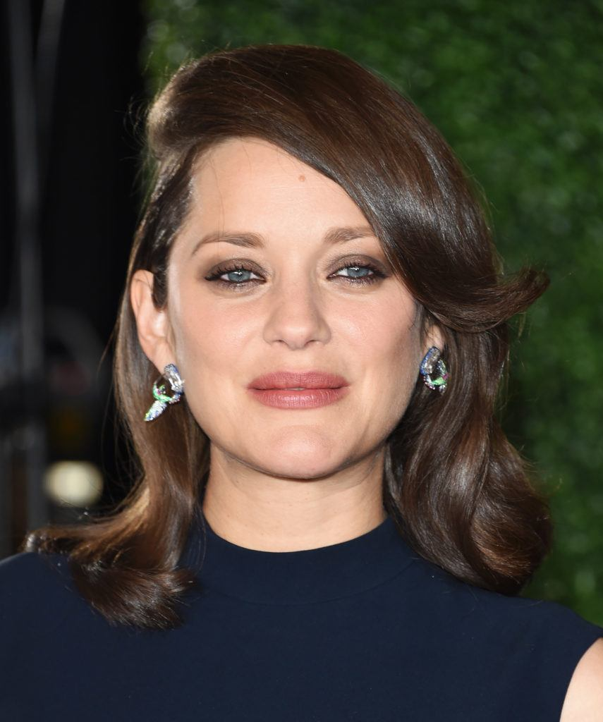 Marion Cotillard with exaggerated swoop bangs on the red carpet