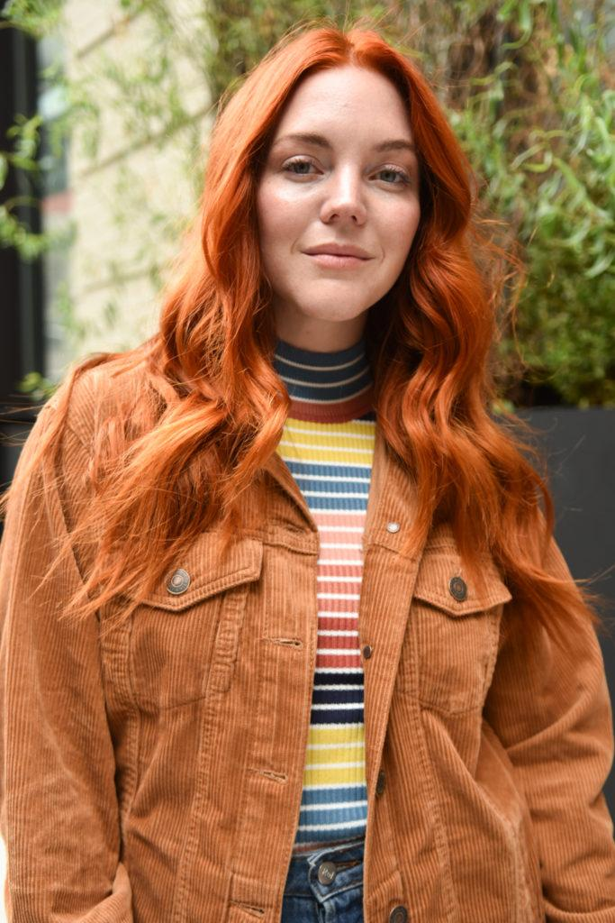 NYFW SS19 street style: Redhead model with long softly curled hair