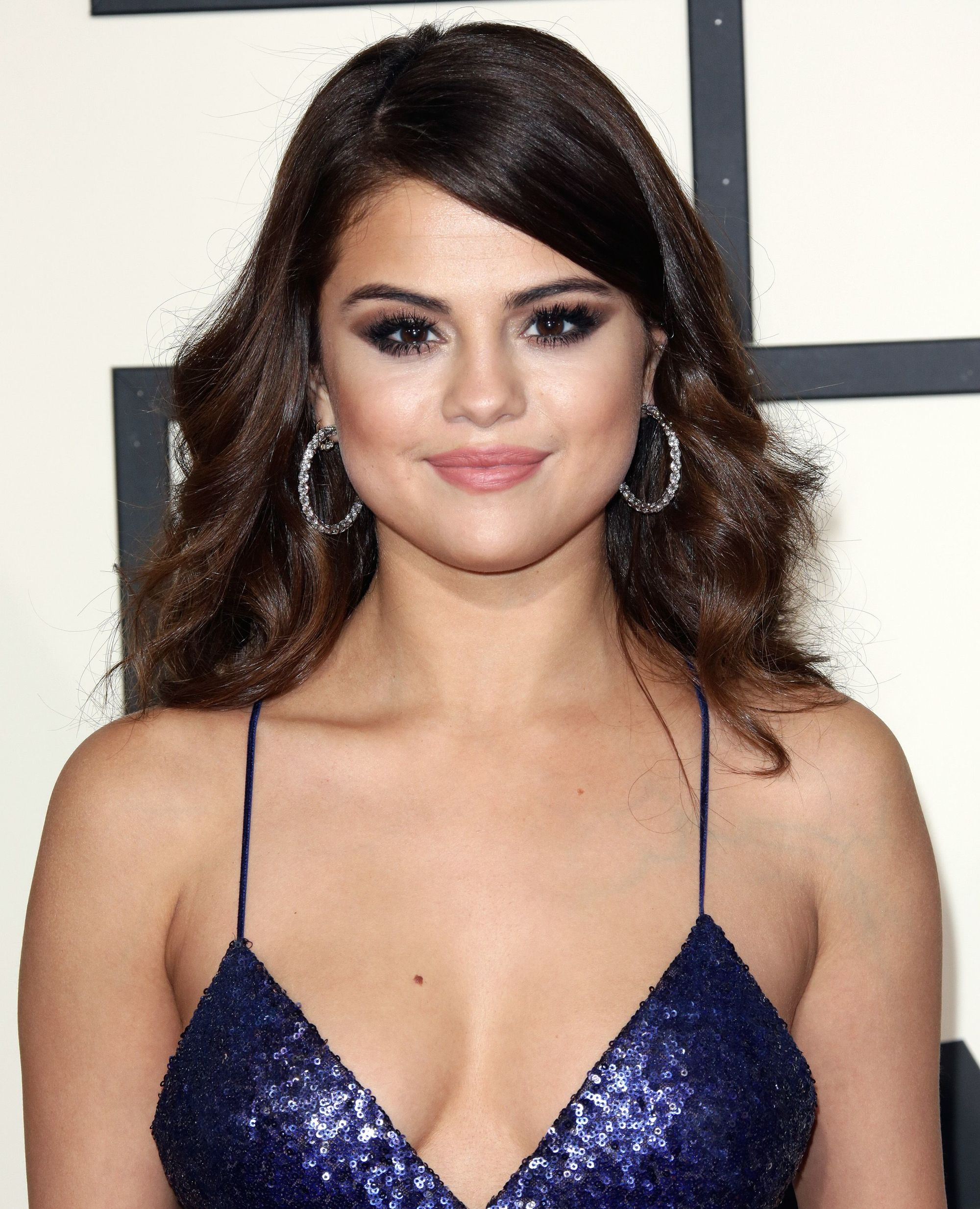 actress and singer selena gomez with a side fringe
