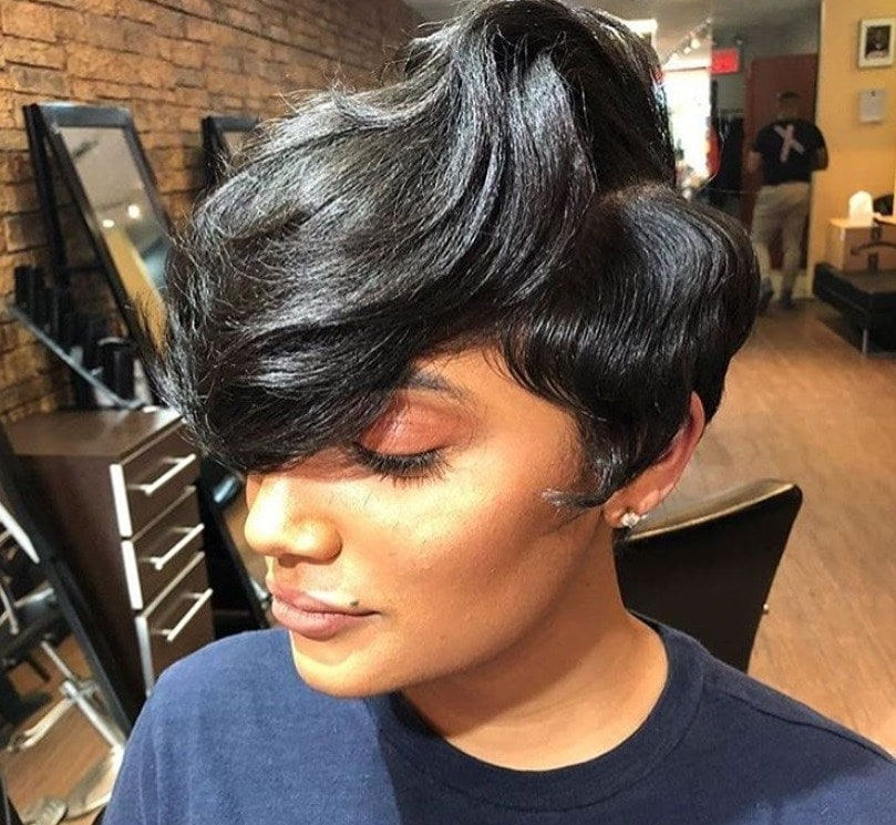 close up shot of woman with long pixie hairstyle, posing in a salon
