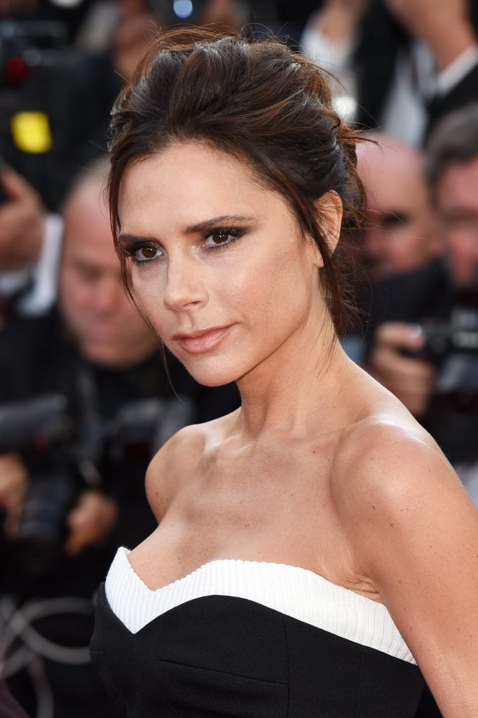 victoria beckham brown hair coiffed updo