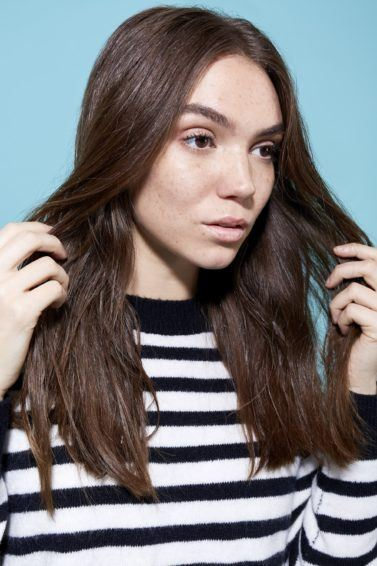 Woman with brunette hair and split ends