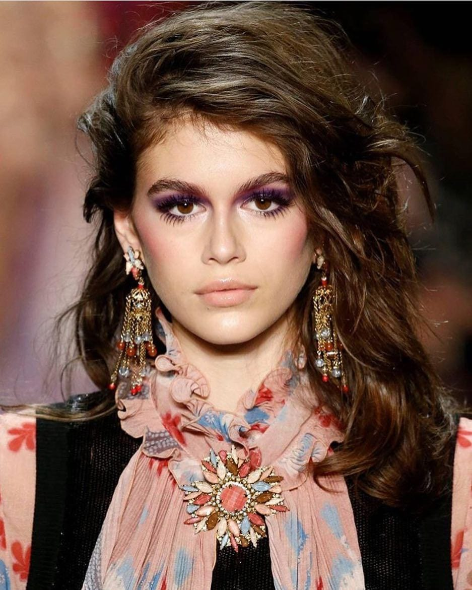 Kaia Gerber on the runway with thick hair