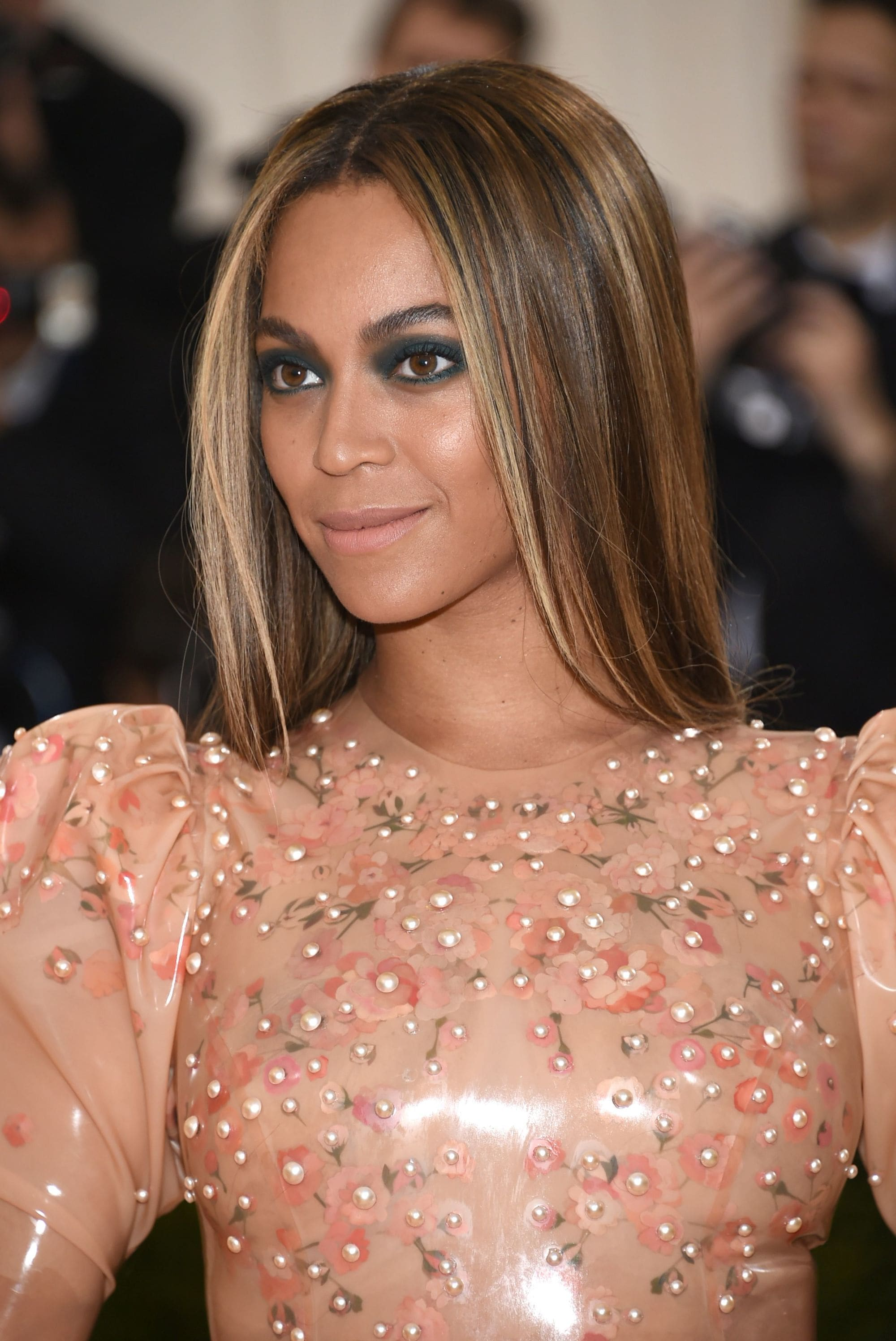 Highlights and lowlights: Beyonce with long straight brown hair with dark eye make-up.
