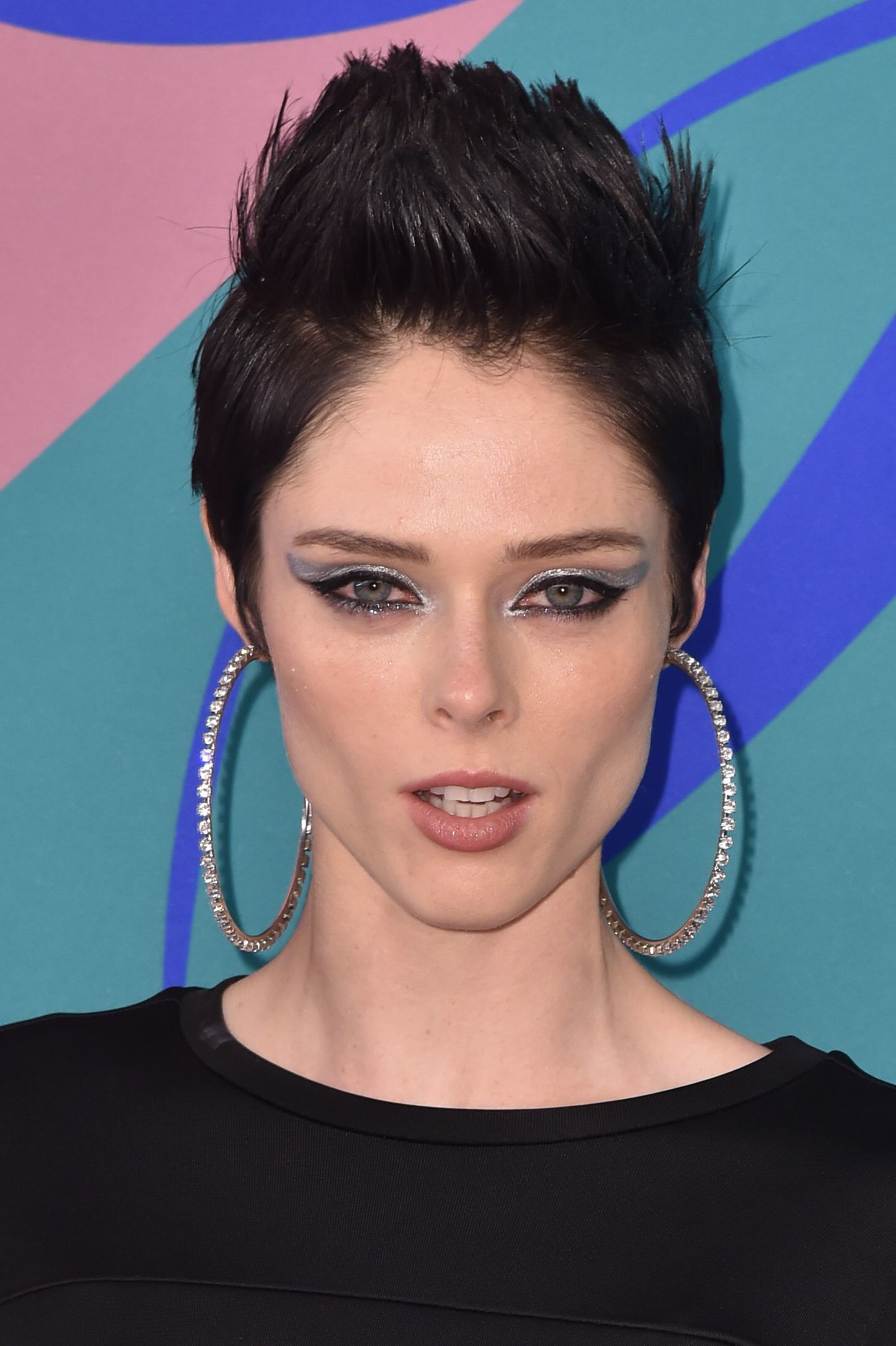 canadian model coco rocha with dark brown hair in a spiked up quiff punk hairstyle