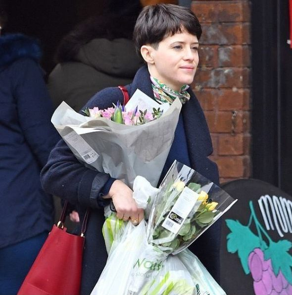 claire foy walking down london street with brown bowlcut hairstyle transformation