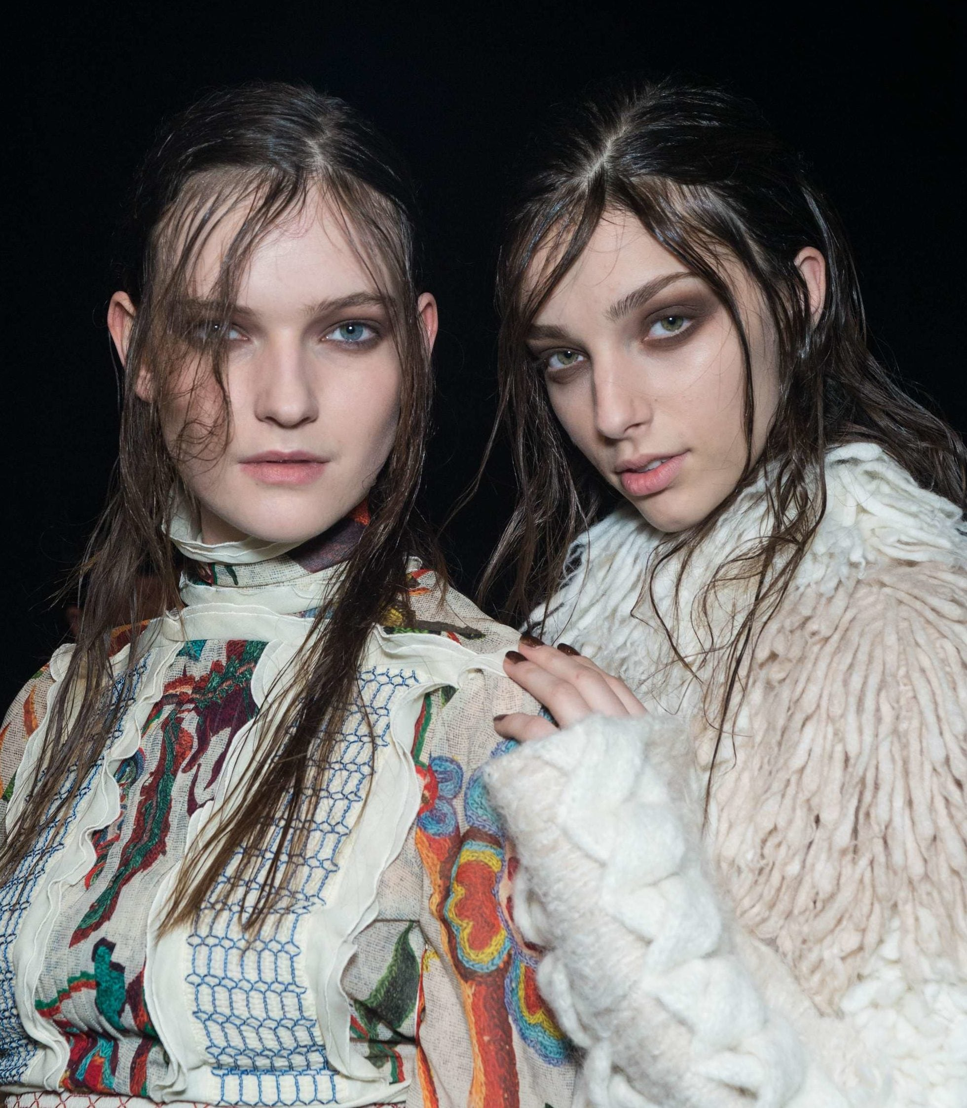 models backstage at just cavalli fw15 show with dark brown greasy straight hair with dark eye make-up