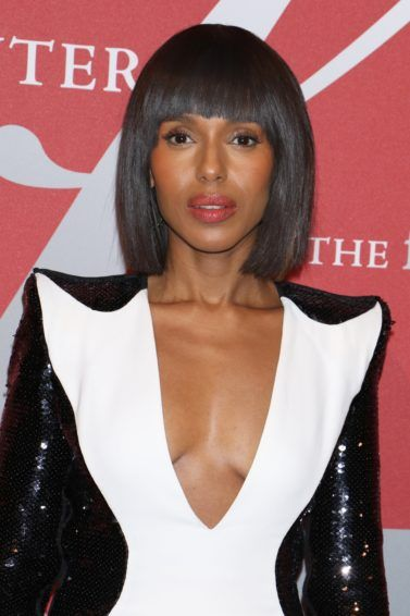 short hairstyles for heart shaped faces: close up shot of kerry washington with short sleek bob haircut, with blunt bangs, wearing black and white v neck dress and posing on the red carpet