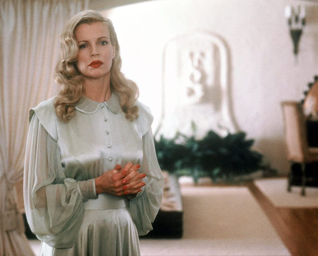 close up shot of kim basinger with vintage 1940s peeakabo waves, wearing silk blue dress on the set of l.a confidentional