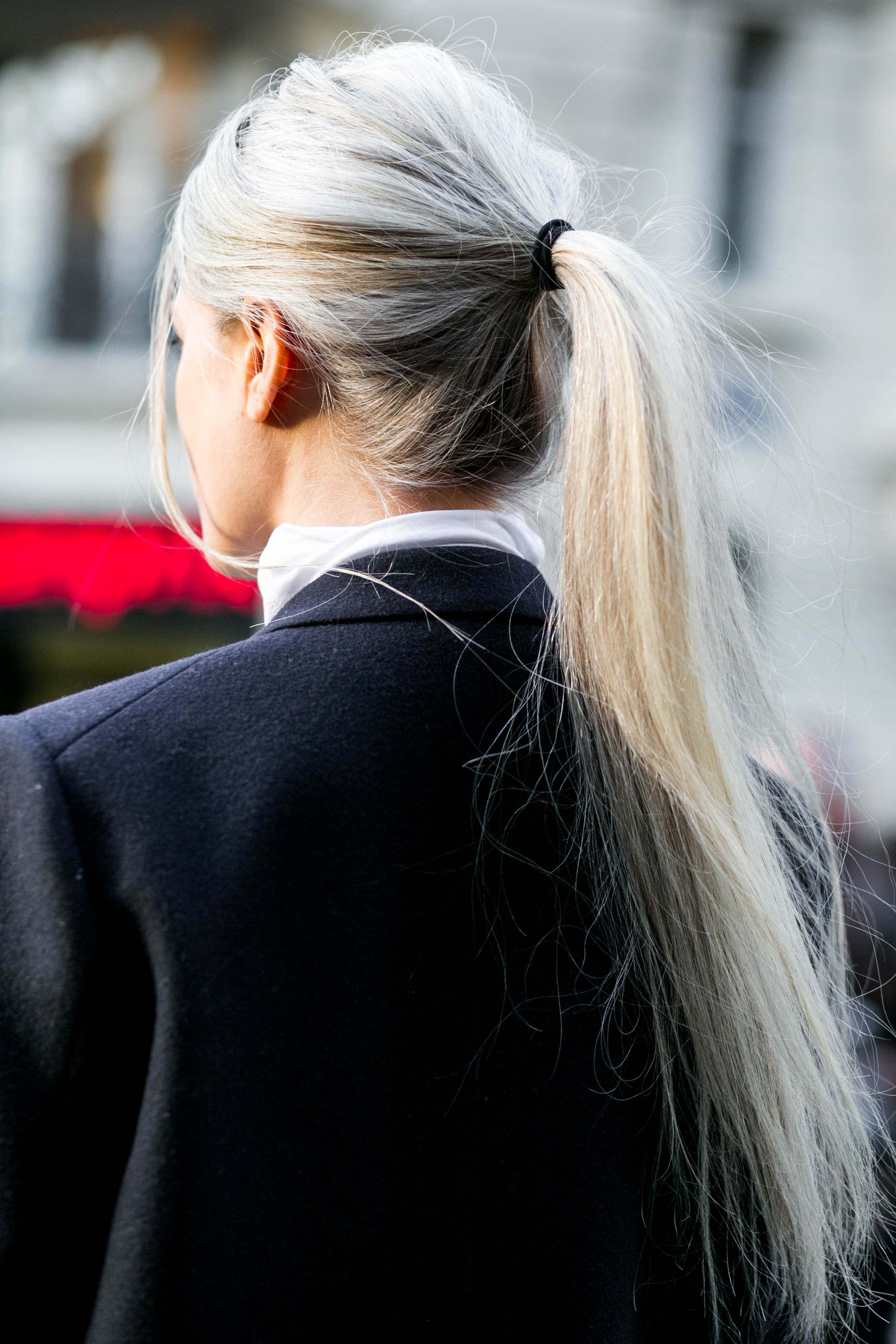 Woman with grey hair long ponytail