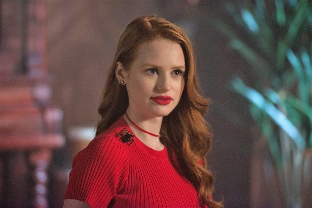 riverdale actress Madelaine Petsch who plays character Cheryl Blossom with long, sideswept red curly hair