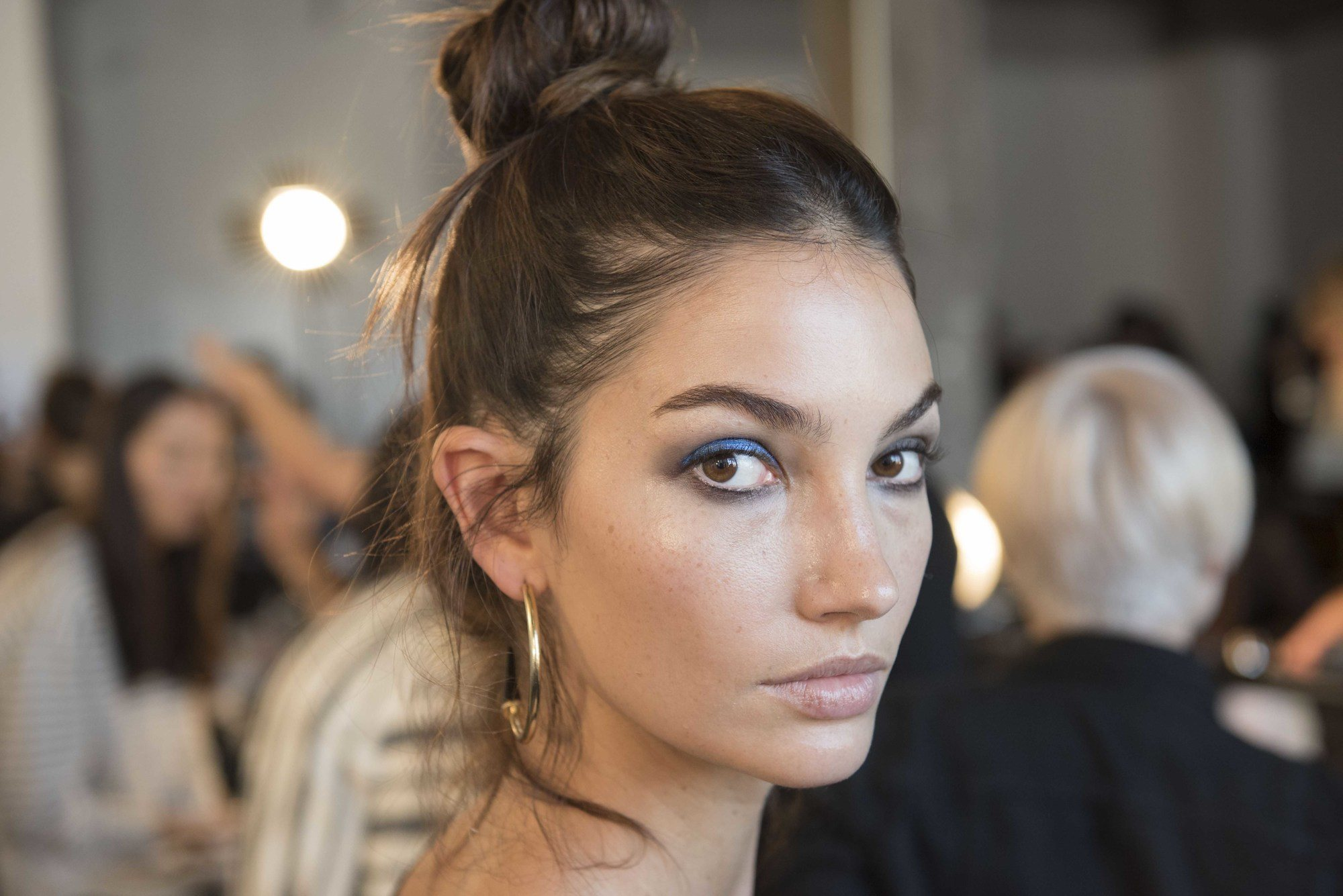 Lily Aldridge backstage at DVF with top knot hair