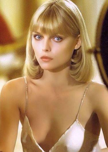 michelle pfeiffer with a curled under blonde bob wearing ivory silk camisole dress