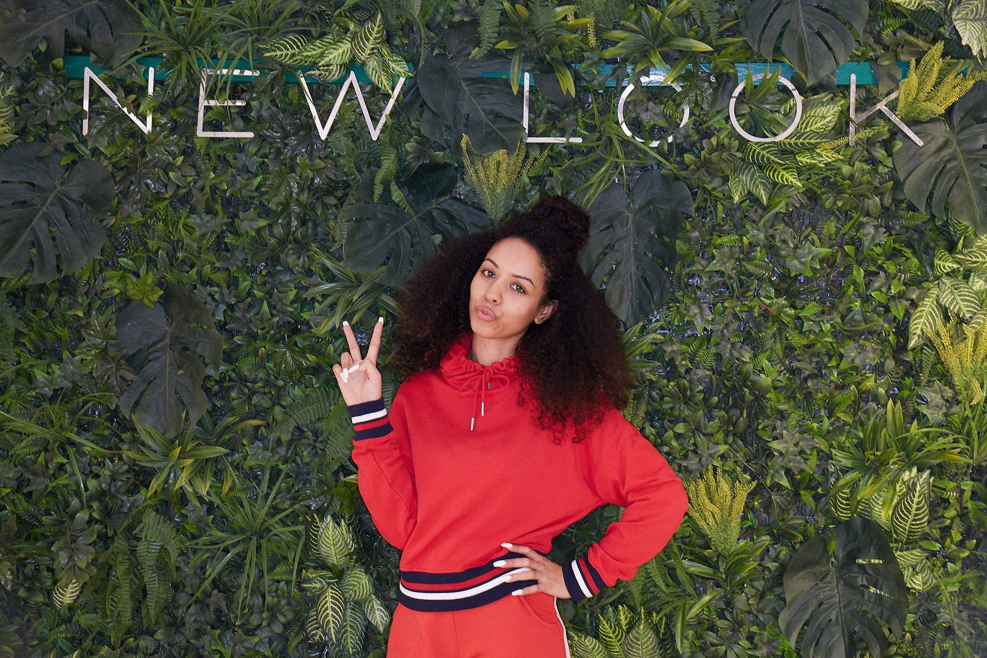 Influencer UK Curly Girl at New Look Store opening with a hun hairstyle