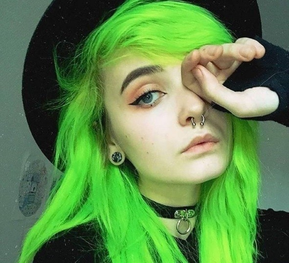Instagram close up shot of woman with neon green hair, side-swept emo fringe, wearing all black