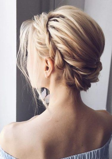 woman with light blonde hair in a prom updo with a rope braid headband detail