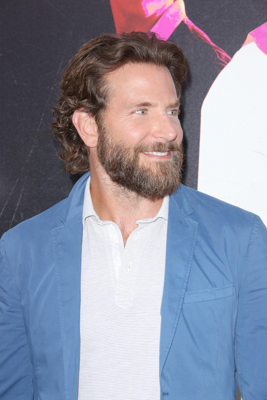 bradley cooper long thick wavy brown hair tucked behind ears with long beard