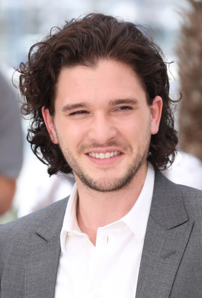 kit harrington with long thick curly brown hair