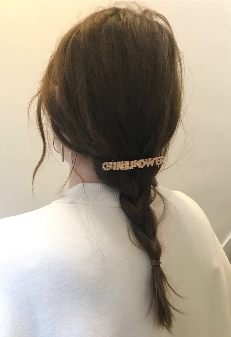 back view of leona with messy wavy braid with girl power statement hair slide