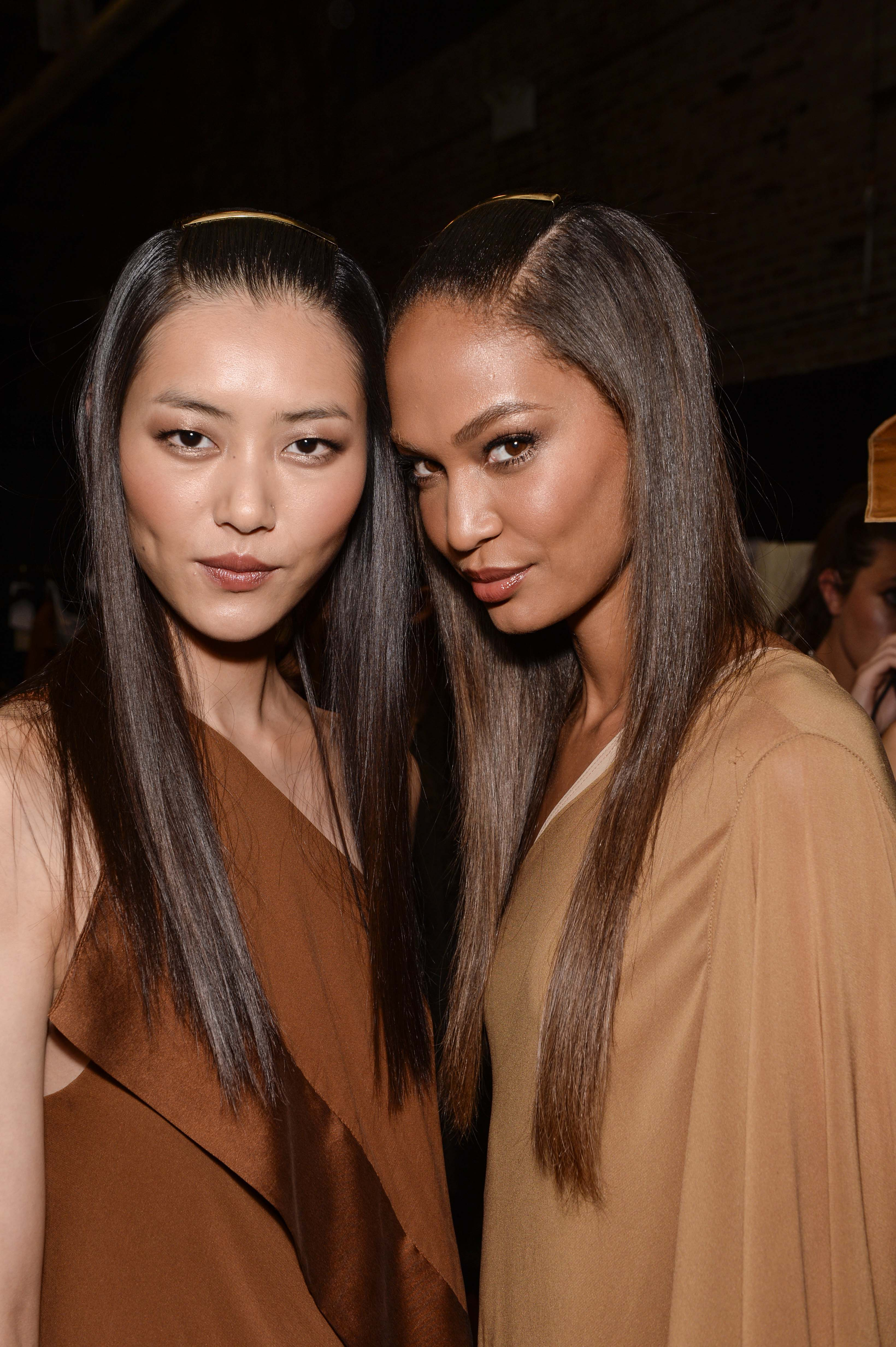 Two women backstage with straight shiny hair