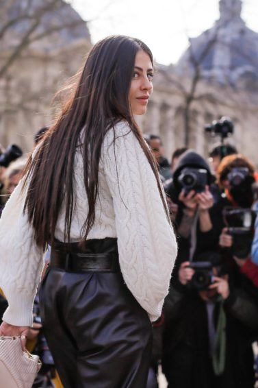 Brunette woman with long thick hair at fashion week