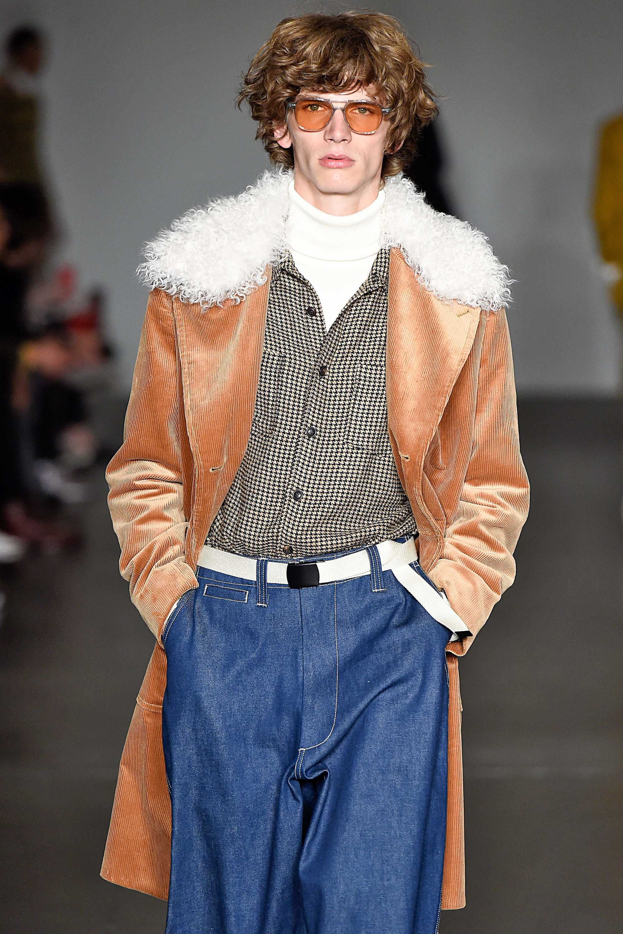 male model on todd snyder fw18 runway with curly medium length golden brown hair