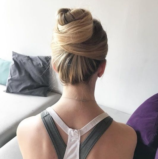 sporty woman with her blonde hair in a neat twisted high bun
