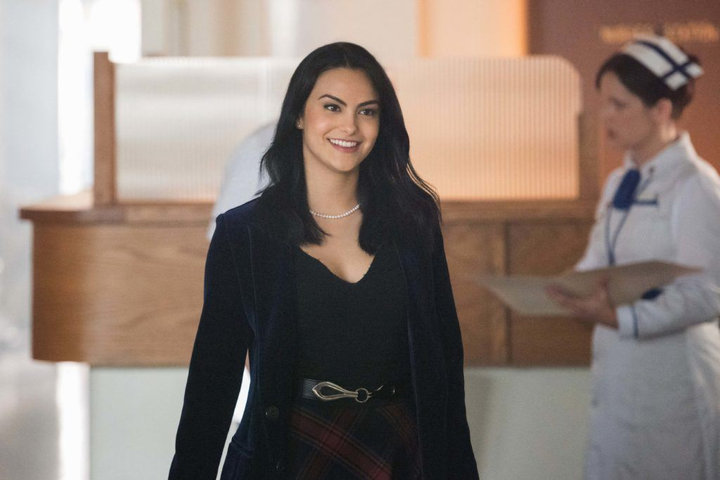 Riverdale actress Camila Mendes in her role as Veronica Lodge with medium length dark sleek shiny hair