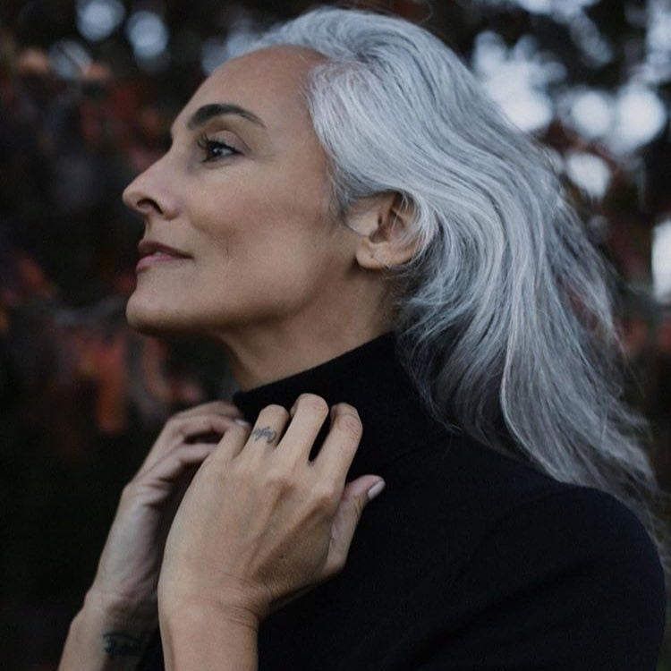 What causes grey hair woman with white hair