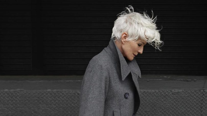 What causes grey hair Maye Musk walking outside