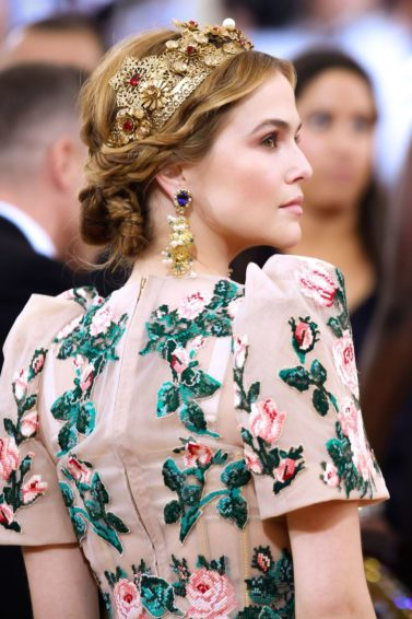 zoey deutch with light brown hair in a braided hairstyle wearing a tiara at the MET gala