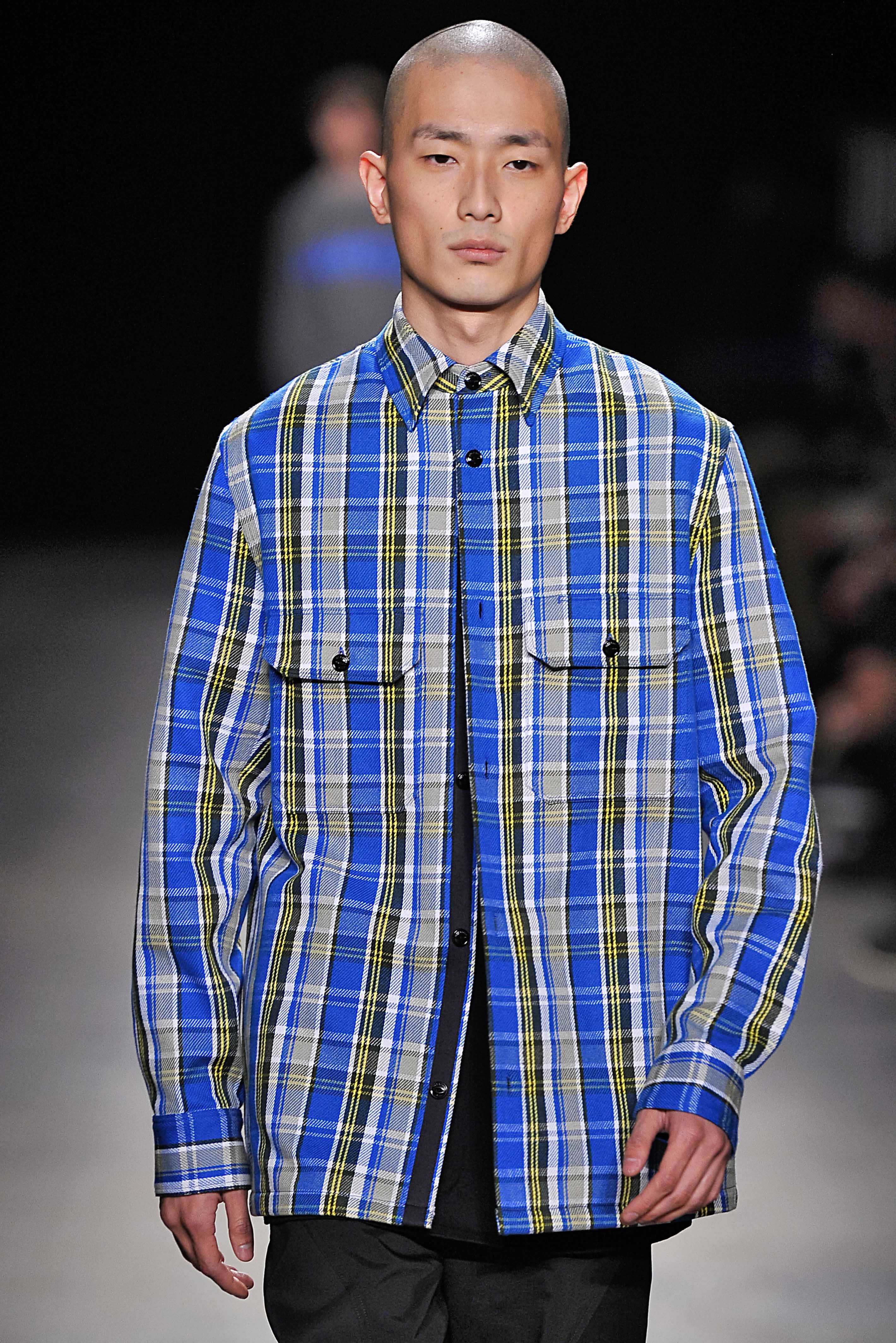 Asian man with shaved head on runway