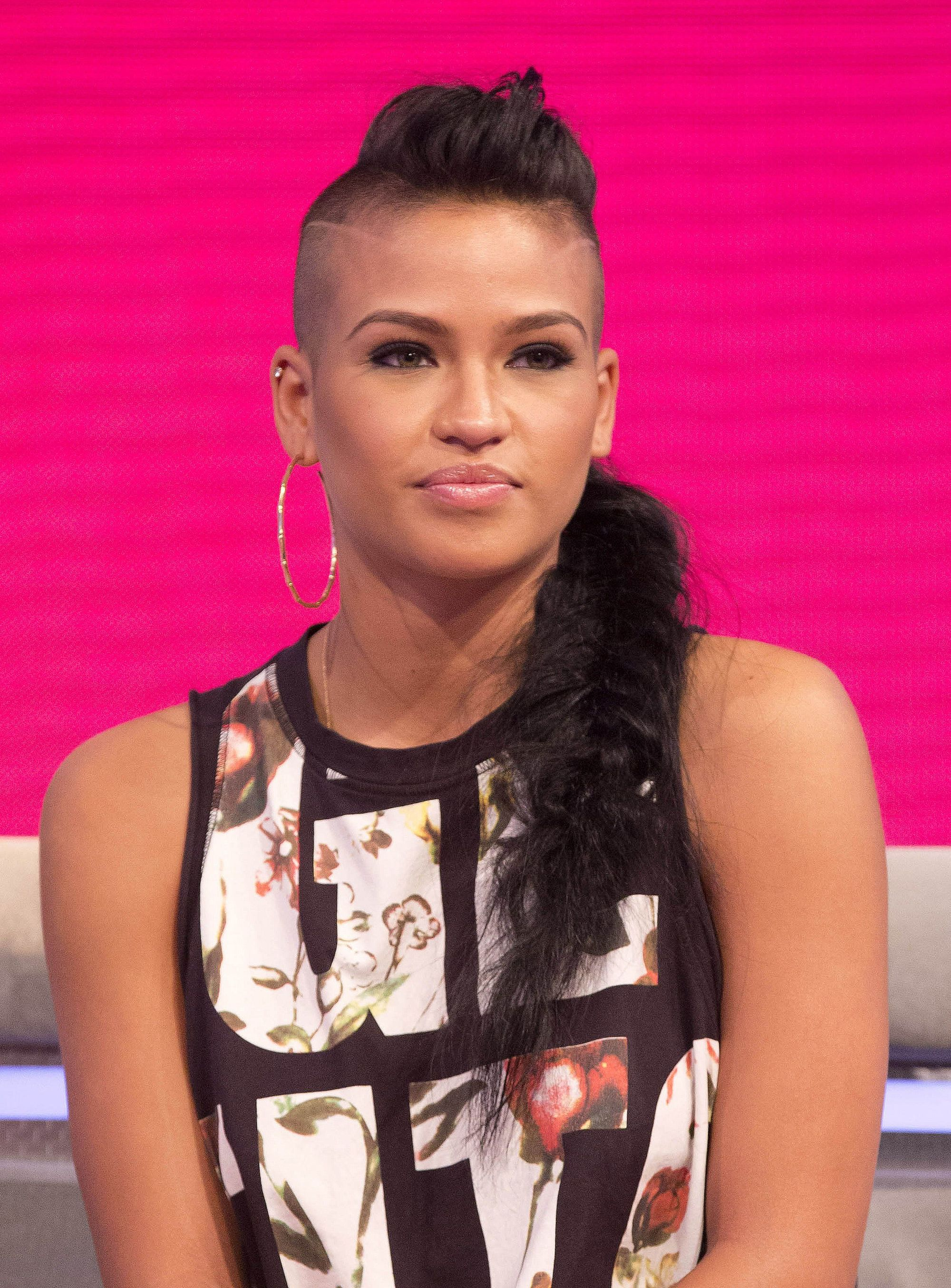 cassie with a shaved mohawk hairstyle braided into a long braid