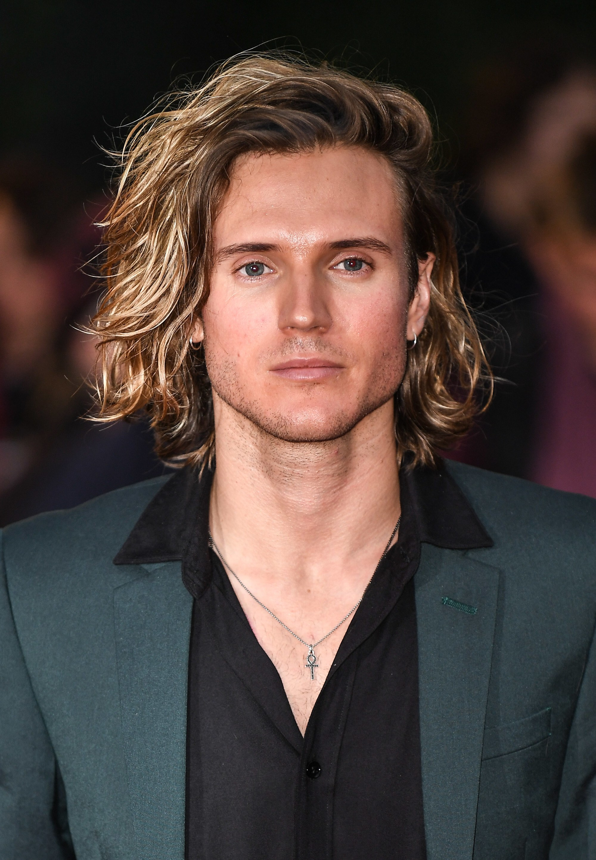 mcfly's dougie poynter on the red carpet with blonde medium length hair swept over to one side
