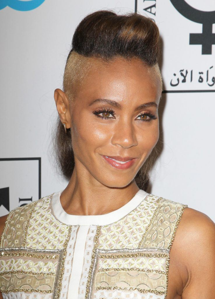 jada pinkett smith with a mohawk hairstyle with shaved sides and styled into a quiff