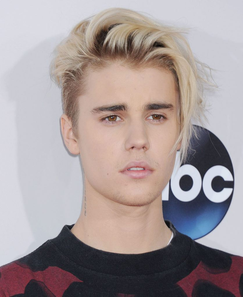 justin bieber with platinum blonde short hair with swooping face-framing layers