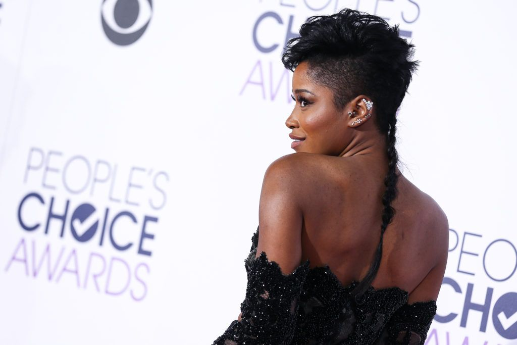 keke palmer on the red carpet with a mohawk hairstyle and shaved sides with a mullet braid