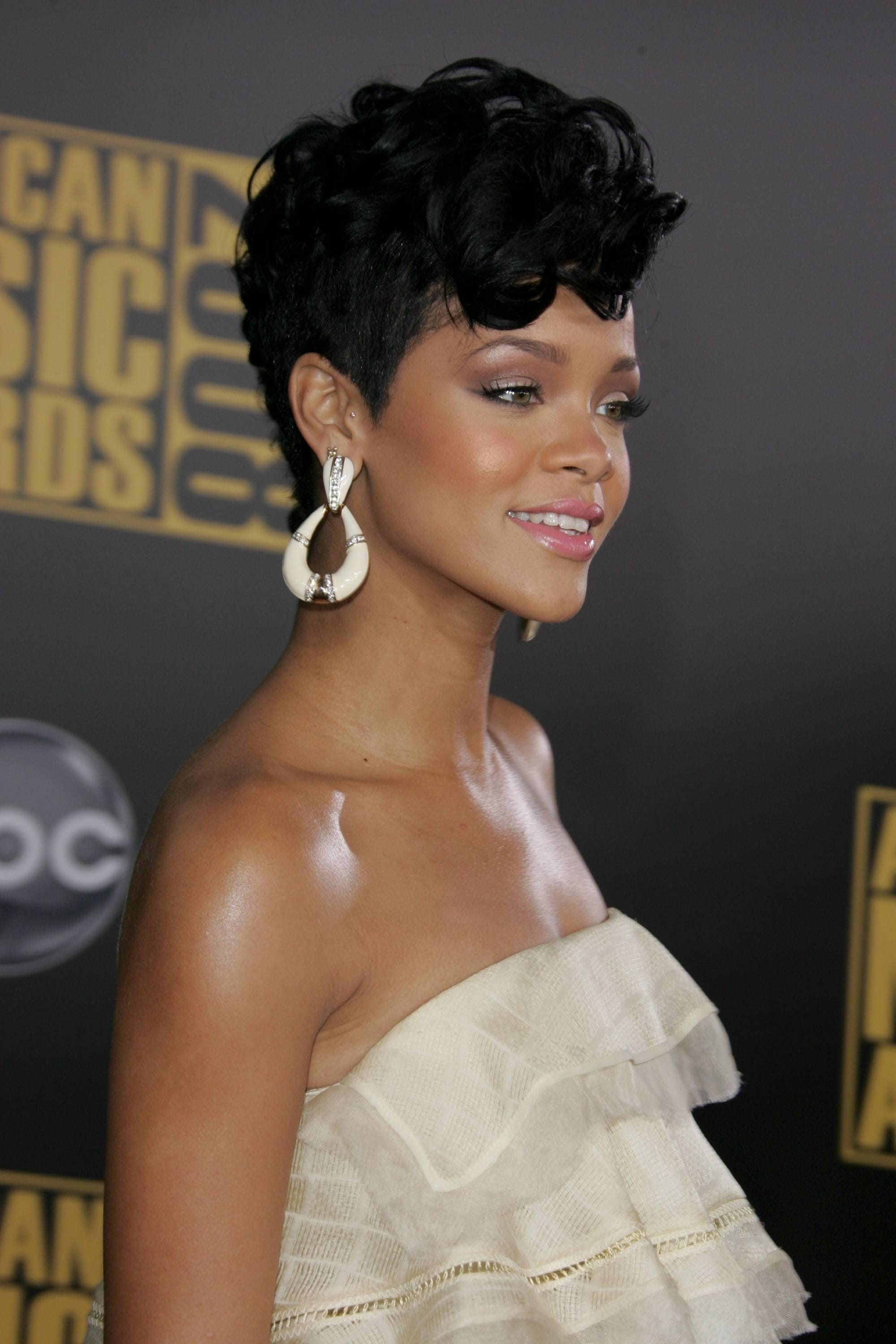 rihanna at the 2008 american music awards with a short curly mohawk hairstyle