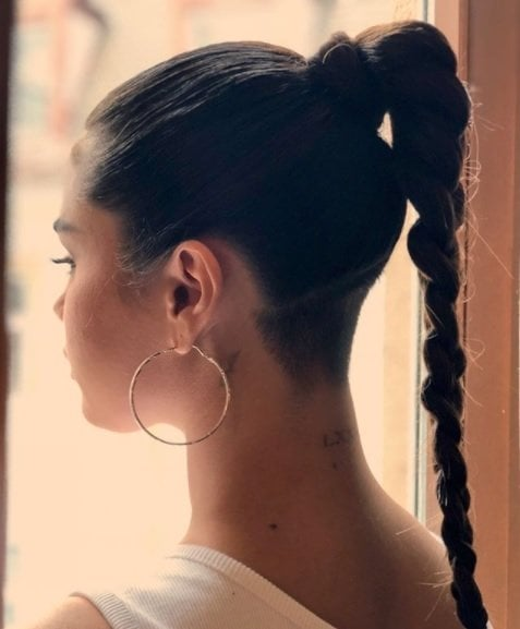 instagram photo of the back of selena gomez' hair in a high ponytail braid with a new shaved undercut