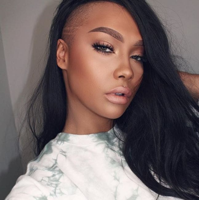 black woman with long dark brown hair with a shaved undercut at front of hair