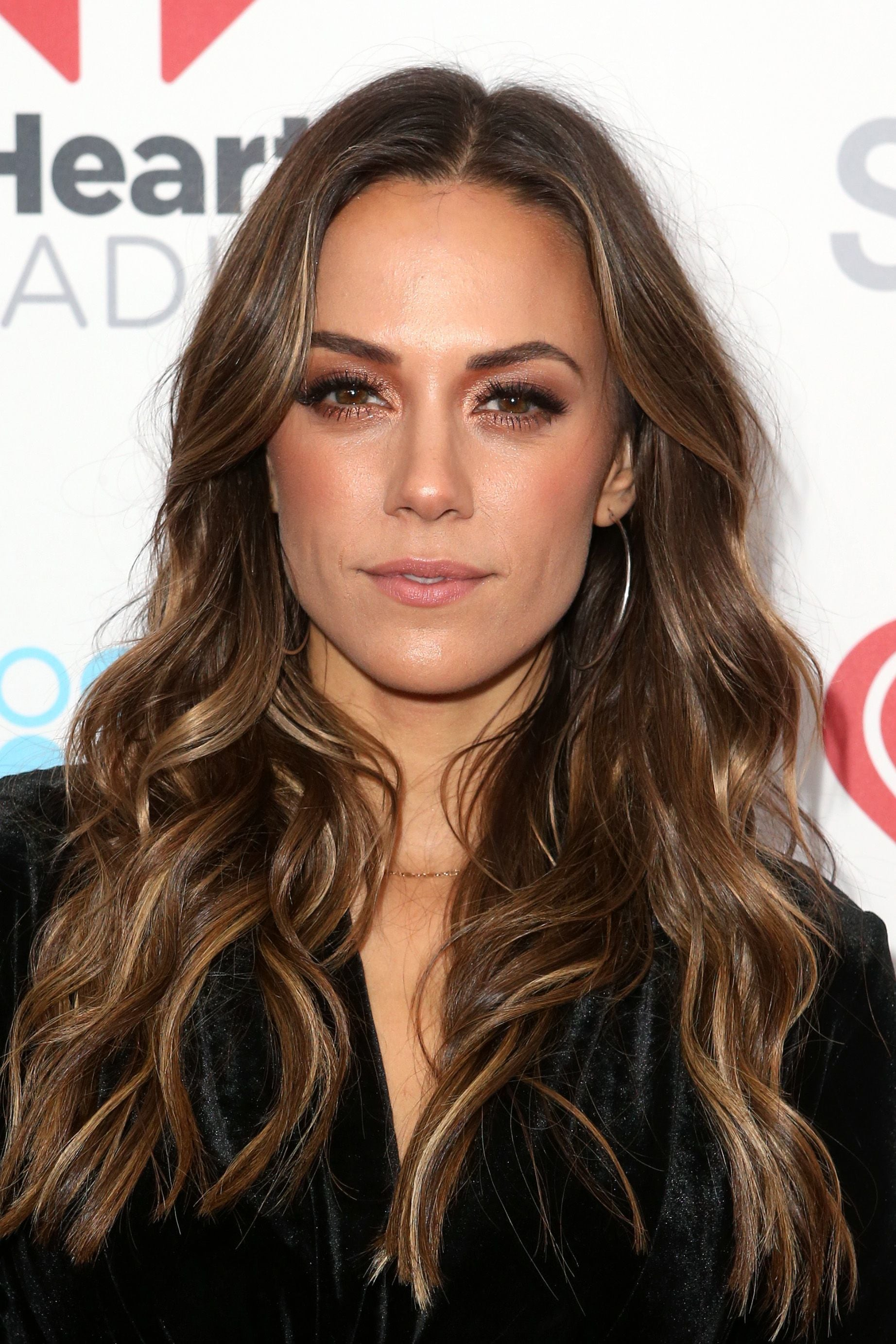 country singer jana kramer with long curly brunette hair with soft brown lowlights