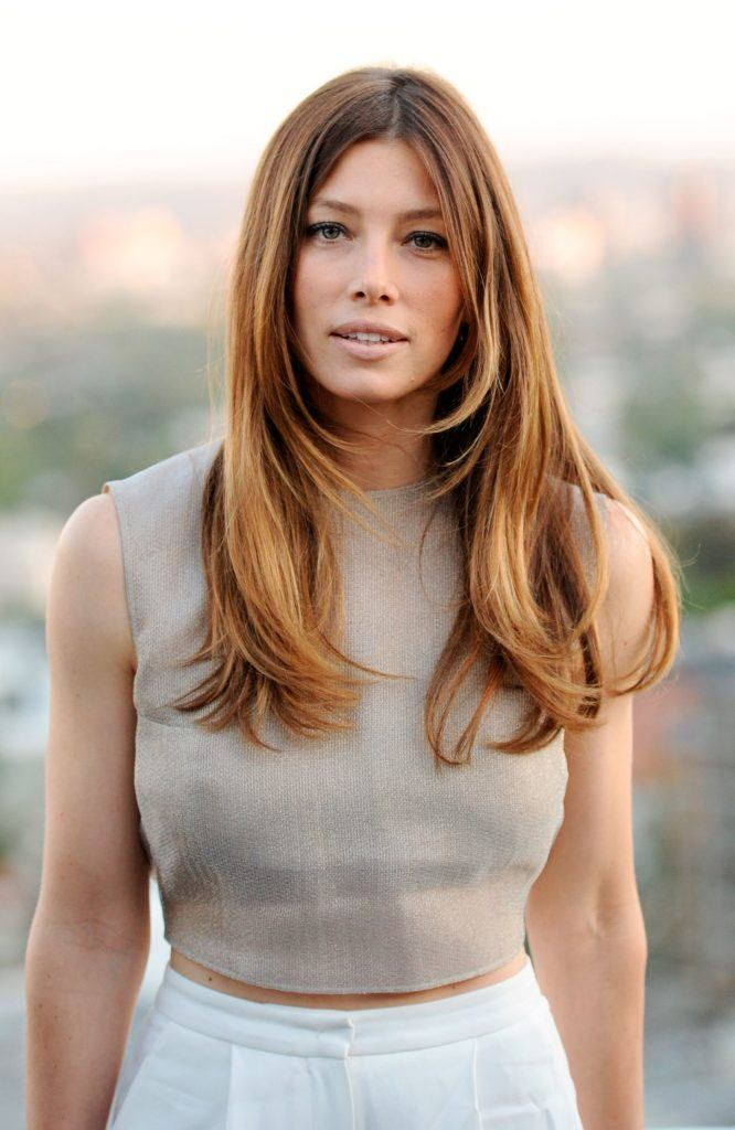 work hairstyles for long hair: jessica biel with long golden brown blowout hair at industry event