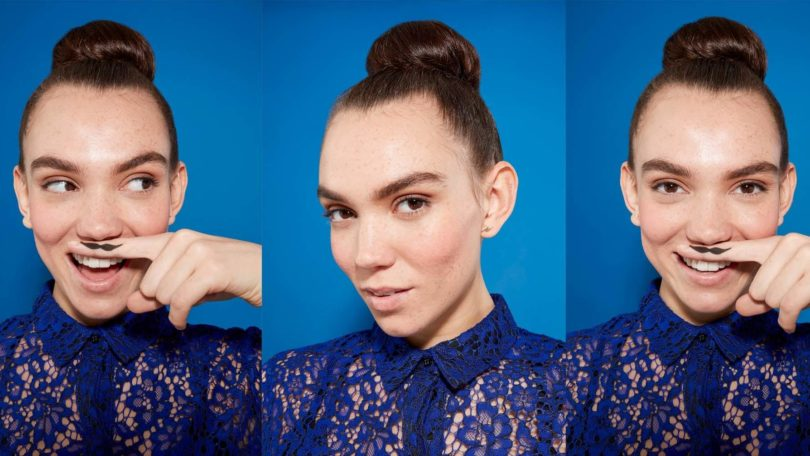 three images of a woman with brunette hair in a tight bun, wearing a blue lace outfit