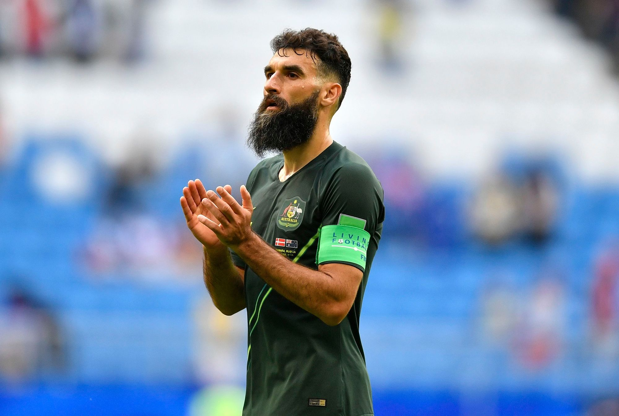 footballer hairstyles: mile jedinak dark brown undercut fade hair with long beard at world cup 2018