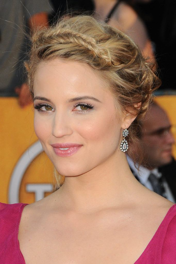 glee actress dianna agron on the red carpet with her blonde hair in an coiffed updo with fishtail braided bangs
