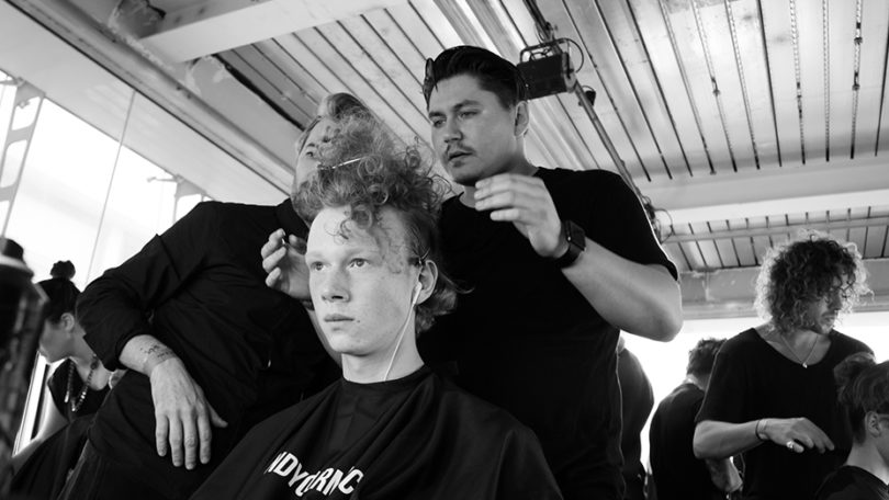 Male grooming: black and white pic of Kieron Webb Global Creative for Lynx and Axe styling hair
