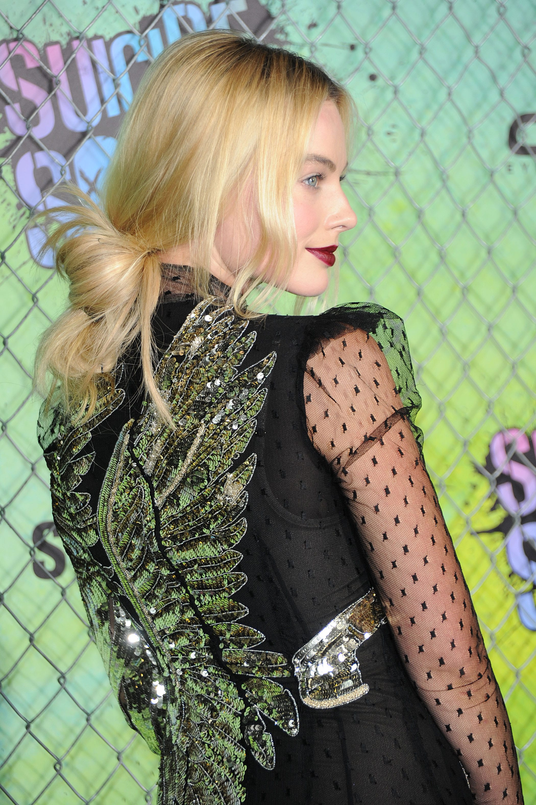 margot robbie at the suicide squad premiere with her long blonde hair in a loose messy low bun
