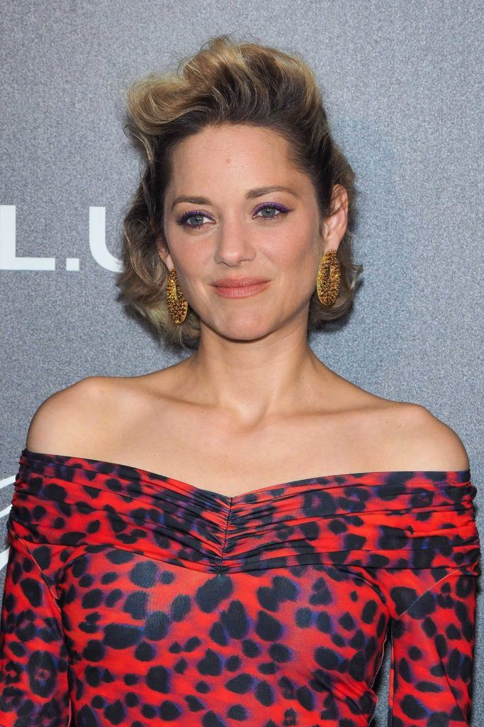 french actress Marion Cotillard with chin length blonde hair styled in retro waves